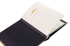 Öppnad bok med tomma sidor och dekorativ ram för text Arkivfoton