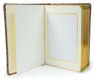 Öppnad bok med tomma sidor och dekorativ ram för text Fotografering för Bildbyråer