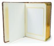 Öppnad bok med tomma sidor och dekorativ ram för text Royaltyfri Foto