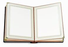 Öppnad bok med tomma sidor och dekorativ ram för text Royaltyfria Foton