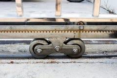 Öppnare för kugghjulglidnings- och hjulport Royaltyfria Foton