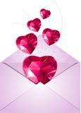 Öppnat kuvert med förälskelsehjärtor Royaltyfri Foto