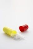 öppnat medicinal för kapsel Arkivfoto