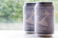 Örebro Sweden 15 october 2017 ice cold falcon beer cans. Örebro Sweden 15 october 2017 two ice cold falcon beer cans standing on a bench in window light royalty free stock photography