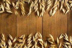 Öron av oaten på trä Fotografering för Bildbyråer