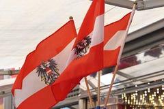 Österrike flaggor Arkivfoto