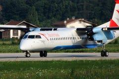 Österrikisk turbopropmotor på landningsbana Royaltyfri Bild