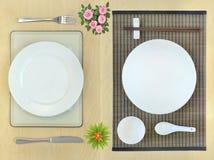 Östliche und westliche Speisetisch Platzeinstellungen Lizenzfreie Stockfotos