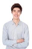 Östlig asiatisk koreansk studiostående för ung man Arkivbild
