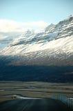 Östliga fjordar, blått hav, snöberg, Island Arkivfoton