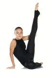 öva gymnastkvinnan Royaltyfria Bilder