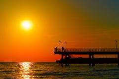 över havssolnedgång arkivfoto