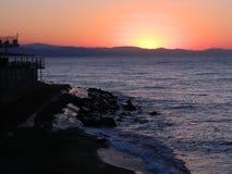 över havssoluppgång Arkivfoto