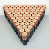 Överflöd av batterier i en triangel Arkivfoton
