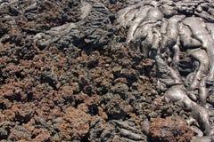 Övergång från slät pahoehoe till rubbly aa-lava Royaltyfri Foto