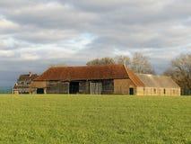 Övergav lantgårdbyggnader på nytt modellerar Farm, Sarratt royaltyfri foto