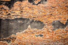 Överge bakgrund för väggen för röda tegelstenar royaltyfri foto