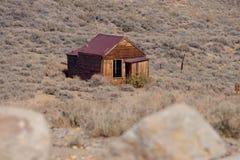 Övergett hus på spökstaden Arkivfoton