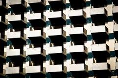 Övergiven byggande fasad med balkonger Arkivfoto