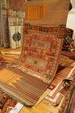 Överlappande mattor med invecklade Kurdish modeller Fotografering för Bildbyråer