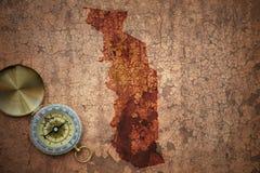 Översikt av Togo på ett gammalt tappningsprickapapper Arkivfoto
