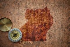 Översikt av Uganda på ett gammalt tappningsprickapapper Arkivfoto