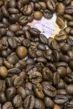 Översikt av Uganda under en bakgrund av kaffebönor Royaltyfri Foto