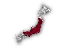 Översikt och flagga av Japan på vallmofrön Fotografering för Bildbyråer