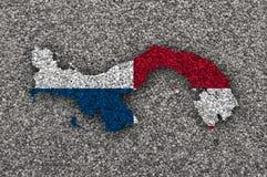 Översikt och flagga av Panama på vallmofrön Arkivfoto