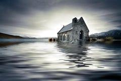 översvämmad kyrka arkivbild