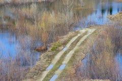översvämmad vägfjädertide Arkivbild