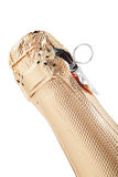 Överträffa av en champagne buteljerar, isolerat Arkivbilder