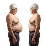 Överviktig man och vanlig viktman över vit Royaltyfria Bilder