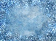 Övervintra blåttbakgrund med snowflakes Arkivfoto