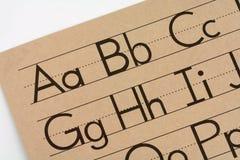 övning för bokbarnhandskrift Arkivbild