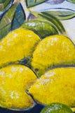 Övre detalj för original- slut för olje- målning - citroner och limefrukter royaltyfri bild