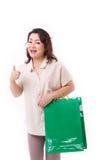 Övre gest för tumme från shoppingkvinna Arkivbild