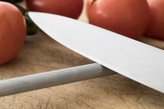 Övre kniv för slut som Honing arkivbilder