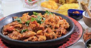 Övre sikt för slut av en feg tikkamasala med indiska kryddor Royaltyfria Foton