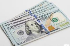 Övre sikt för slut av högen av dollar Arkivfoto