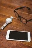 Övre sikt för slut av smartphonen och exponeringsglas Fotografering för Bildbyråer