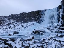 Öxarárfoss Waterfall in winter covered in ice ans snow. royalty free stock photos