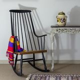 ٍٍRocking chair and old style vintage table on background of off white wall stock images