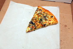 Última fatia de uma pizza Fotografia de Stock Royalty Free