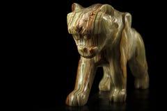 Única figura de pedra de um tigre Imagens de Stock