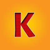 Única fonte do caráter K na cor alaranjada e amarela Imagem de Stock Royalty Free