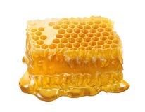 Única parte do favo de mel Fatia do mel isolada no fundo branco fotografia de stock