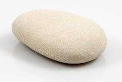 Única pedra isolada no fundo branco Imagens de Stock