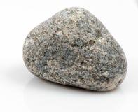 Única pedra isolada no fundo branco Foto de Stock Royalty Free