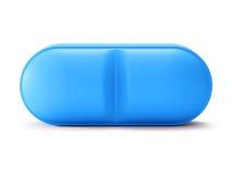 Único comprimido azul no branco Imagens de Stock